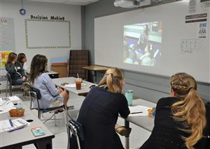 Teachers observe classroom with Olivia Wahl